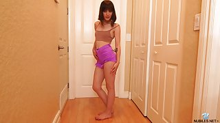 Dark haired alone bitch Nala Nova uses a toy to masturbate in the hall