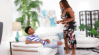 Aroused ebony twerks her thick ass with the son's dick inside her