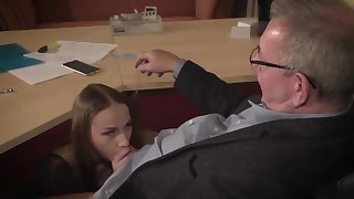 Amazing brunette with glasses is having a ffm threesome at work and enjoying it a lot